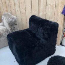 Black sheepskin cube chair